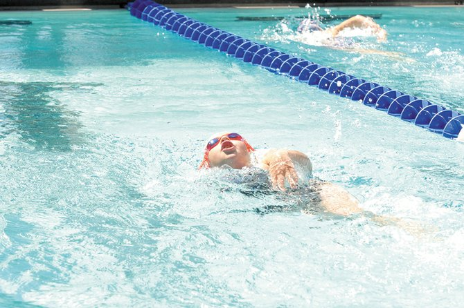 Alexa Neton, 8, competes in the 100-meter freestyle Friday during the Colorado seasonal state swim meet at the Craig Swimming Complex. The Craig Sea Sharks have 12 athletes competing in 33 events during the three-day meet, which continues at 8 a.m. today and Sunday.