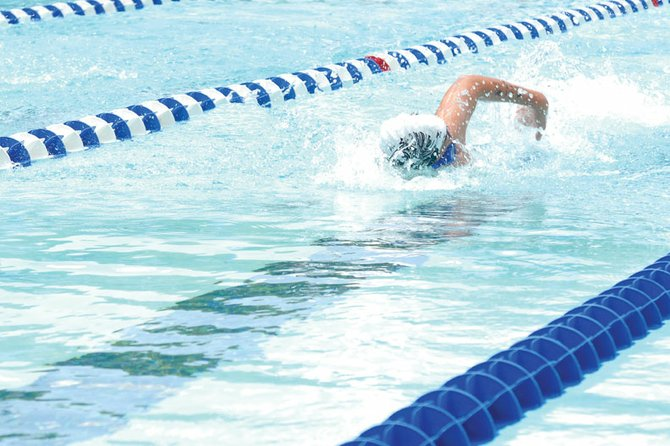 Colby Beckett, 11, competes in the boys 11- to 12-year-old 50-meter freestyle Sunday during the Colorado seasonal state swim meet at the Craig Swimming Complex. Beckett, who swims as part of the Craig Sea Sharks, said practice has helped him lower his times throughout the season.