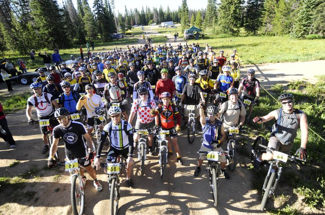Participants in the second annual Ride 4 Yellow mountain bike ride gather before the start of the 26-mile challenge Aug. 7. The proceeds from the 2011 Ride 4 Yellow and Ski 4 Yellow events will be split between local cancer causes and the Livestrong Foundation.