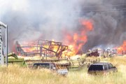 A fire burns an unidentified wooden structure today off Moffat County Road 7. The blaze has affected 60 acres of private and public land.