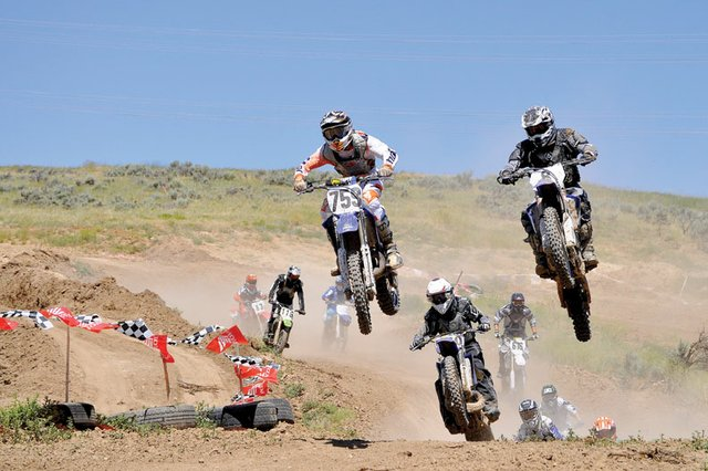 David Dempster, right, of Craig, battles for the lead Sunday during a motocross race at Thunder Ridge Motorsports Park.