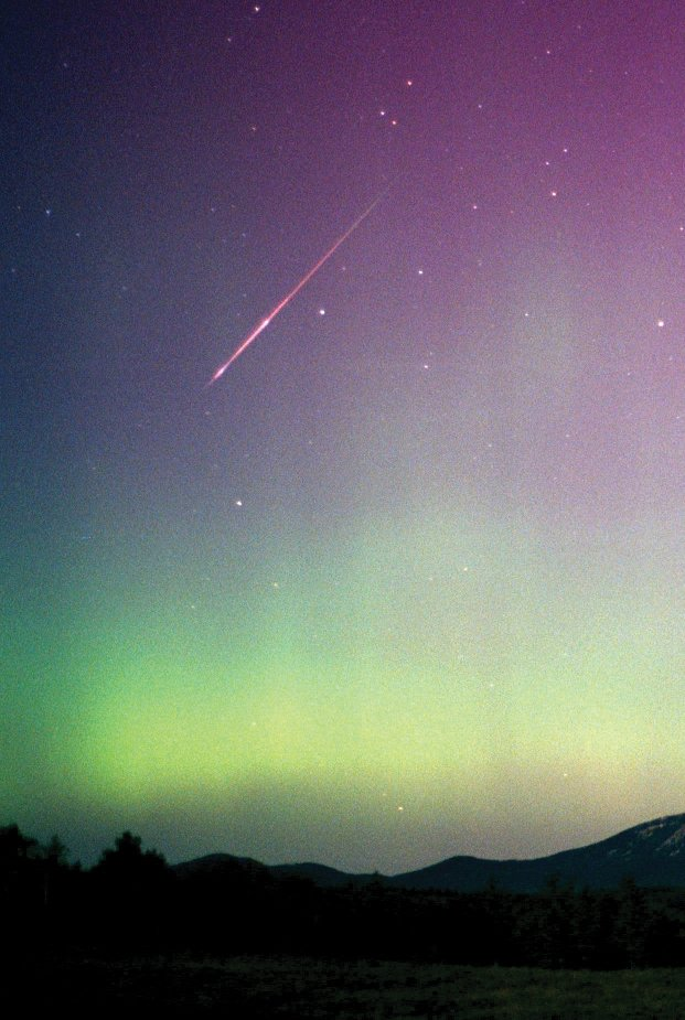 This year's full Fruit Moon likely will wash out many faint Perseid meteors, but don't let that stop you from enjoying the show. In this photograph, taken near Hahn's Peak the morning of Aug. 12, 2000, neither the bright moonlight nor a vivid display of the northern lights could drown out this Perseid fireball.