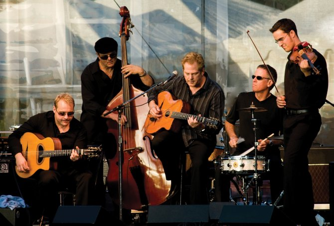John Jorgenson, center, leads the John Jorgenson Quintet with his gypsy jazz guitar style. The band plays at 8 p.m. today at Strings Music Pavilion. Tickets are $35.