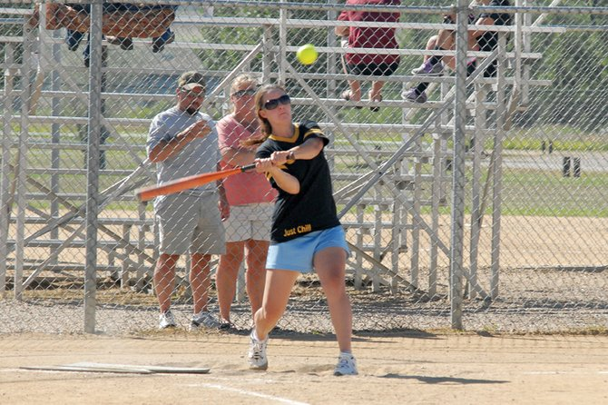 Peyton Bulla, playing for the Flint Personnel softball team, swings Saturday during the Craig Softball Association's league tournament at Loudy-Simpson Park. TCB Contracting beat Ace Painting for the A-league title and Triple M Electric defeated Anthony's for the B-league championship.