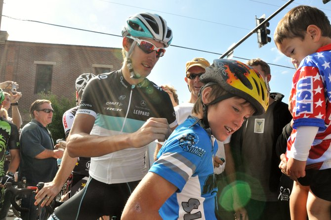 Andy Schleck signs the back of Zane Worrell's jersey Monday morning before more than 100 Steamboat Springs cyclists joined Schleck on a community bike ride.