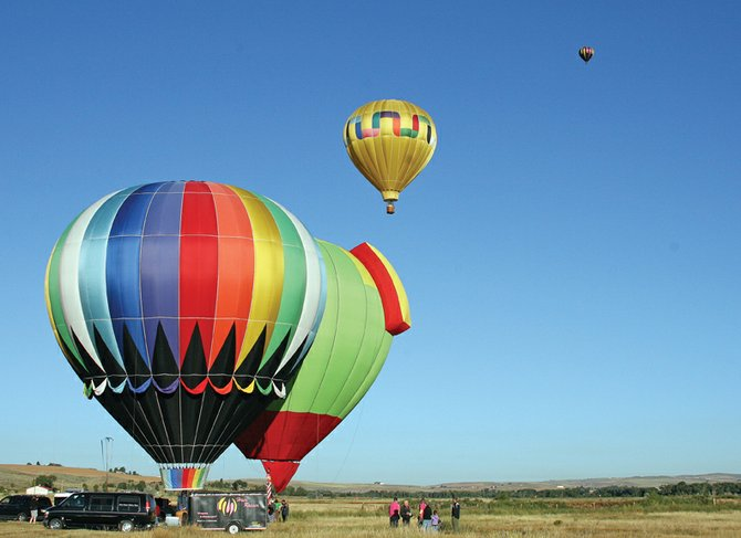 Hot air balloons take flight during last year's Moffat County Hot Air Balloon Festival. This year's event is scheduled for Friday, Saturday and Sunday at Loudy-Simpson Park and Yampa Valley Golf Course.