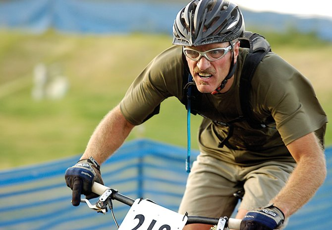 JP Pougiales races down on Emerald Mountain during the Dog Days of Summer Town Challenge Mountain Bike Race Series on Aug. 6, 2009. This year's race starts at 5:30 p.m. Wednesday.