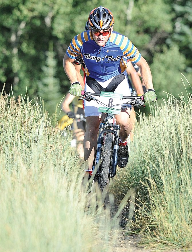Adam Parke makes the first climb of Wednesday's Dog Days of Summer Town Challenge Mountain Bike Series.
