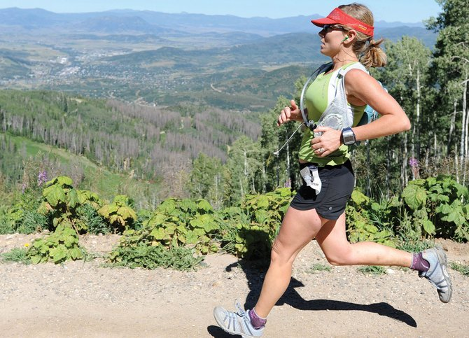 The sold-out Continental Divide Trail Run provides breathtaking views of the Yampa Valley during its 16-mile course from Fish Creek Falls up the back side of Mount Werner and down to Thunderhead. Here, Cara Marrs nears the finish of the 2010 race.