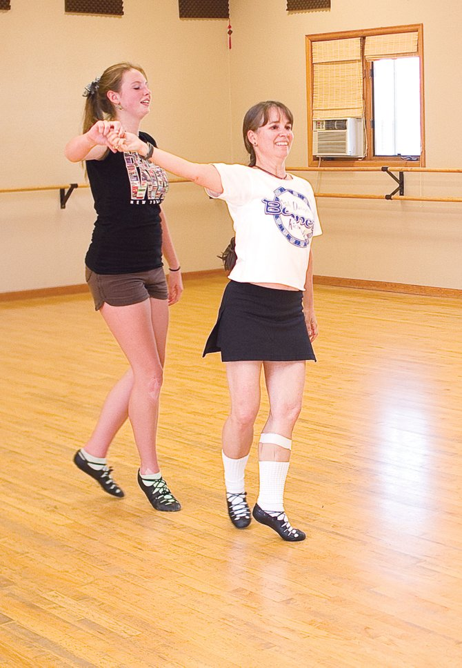 Student McKendrey McGown, left, and instructor Nora Parker dance at the Elevation Dance Studio in Steamboat Springs. Parker is opening her own studio, a chapter of the Bennett School of Irish Dance, next week at Excel Gymnastics.