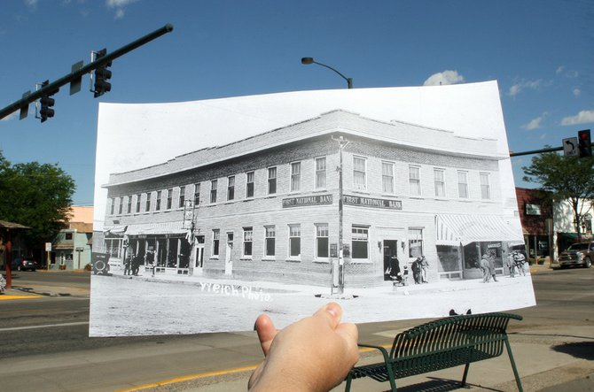 A photo of the First National Bank building by photographer George Welch is held in today's environment, 506 Yampa Ave., on Wednesday morning. The image, photographed in the same manner as those depicted on the website www.dearphotograph.com, is the third in a series the Craig Daily Press is calling Dear Moffat County. Find out more at www.craigdailypress.com/dearmoffatcounty.