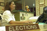 Stephanie Beckett, Moffat County's elections supervisor, visits www.govotecolorado.com Friday in her office at the Moffat County Courthouse, 221 W. Victory Way. The elections office is one of four locations where residents can register to vote.