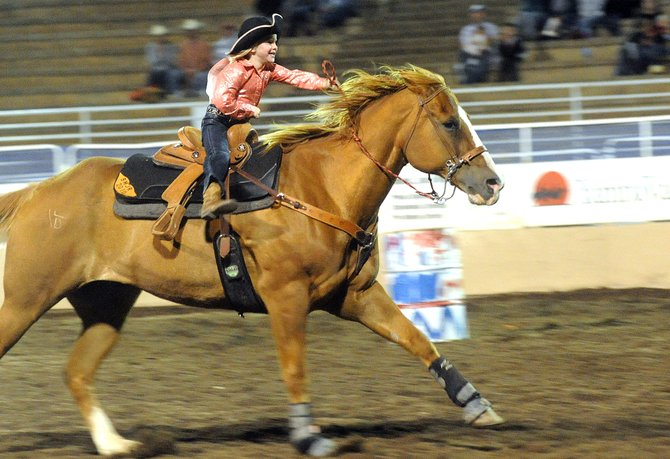 Katie Jo Knez, 5, of Craig, rides to the season championship Saturday in pee-wee barrel racing at the Steamboat Springs Pro Rodeo Series, which wrapped up a 21-performance, 10-week run in Steamboat Springs.
