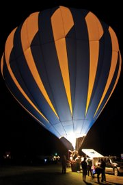 A hot air balloon is illuminated in the night sky during Saturday's balloon glow as part of the Moffat County Hot Air Balloon Festival.
