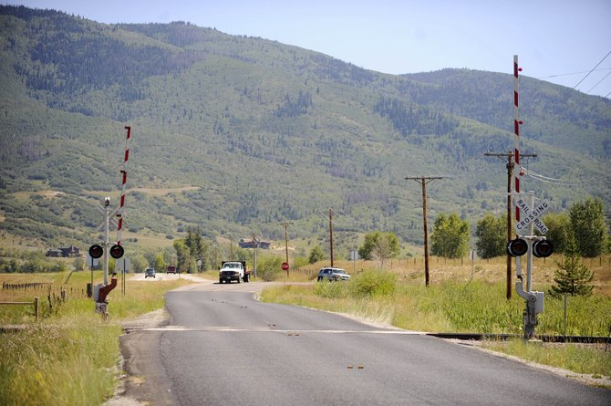 Competitors in the USA Pro Cycling Challenge will turn off Colorado Highway 131 onto this stretch of Routt County Road 14F, where they will cross railroad tracks and ride 0.4-miles of road that recently was chip-and-sealed.
