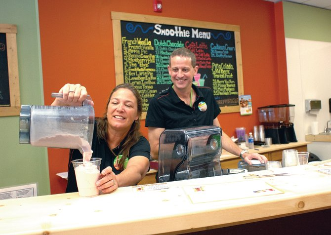 Wendy Mark, left, and Doug Smith work behind the counter at the Sundance Health Zone. The two entrepreneurs opened the business earlier this summer and hope to provide a menu that includes smoothies and other beverages with a nutritious flair.