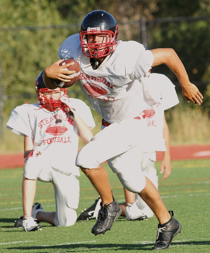 Steamboat Springs High School senior Tyler Brown looks for some running room during practice Tuesday at Gardner Field.