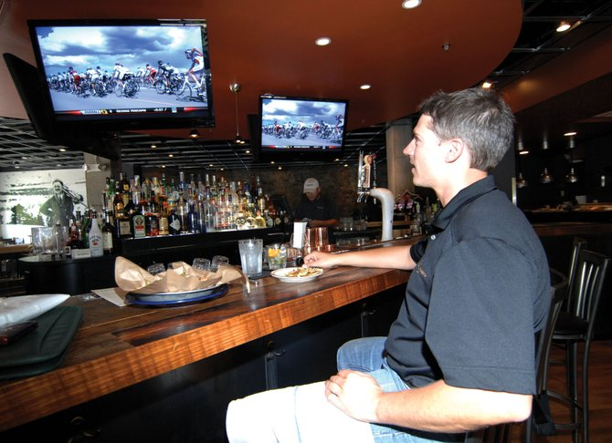 Marc Bennett watches the opening stage of the USA Pro Cycling Challenge on Tuesday afternoon inside Carl's Tavern. About 130 professional cyclists will ride into town Friday afternoon and leave Saturday morning over Rabbit Ears Pass, and Steamboat officials are confident the hard work put into the event will pay off.