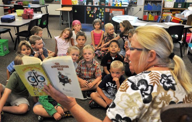 Karen Draper reads a book to her first grade class Wednesday at Strawberry Park Elementary School. Students in Steamboat Springs returned to school Wednesday from their summer vacations.
