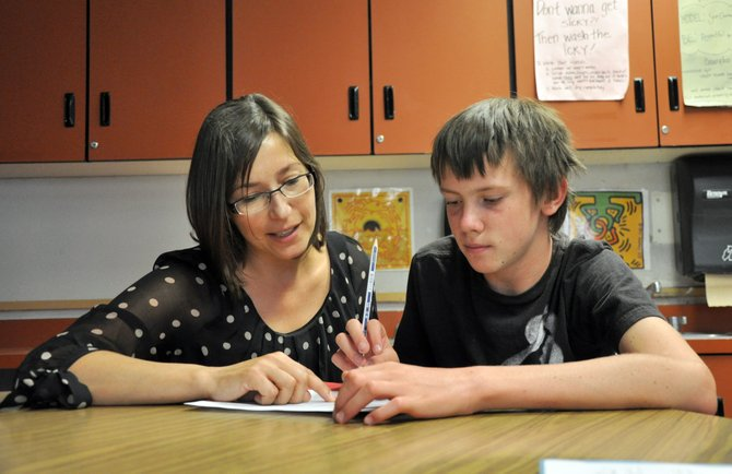 Susanmarie Oddo goes over back to school paperwork with eighth grade student John Zalesky on Wednesday during the first day of school at Steamboat Springs Middle School. Oddo has been named a semifinalist for the Colorado Teacher of the Year award.