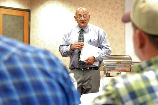"Ralph Cantafio, an area attorney who specializes in mineral leases and land use agreements, discusses the future of oil and natural gas exploration in Moffat County during a presentation Monday night. Thirty-one residents attended the seminar, titled ""Trends in Oil and Gas Affecting Northwest Colorado."""