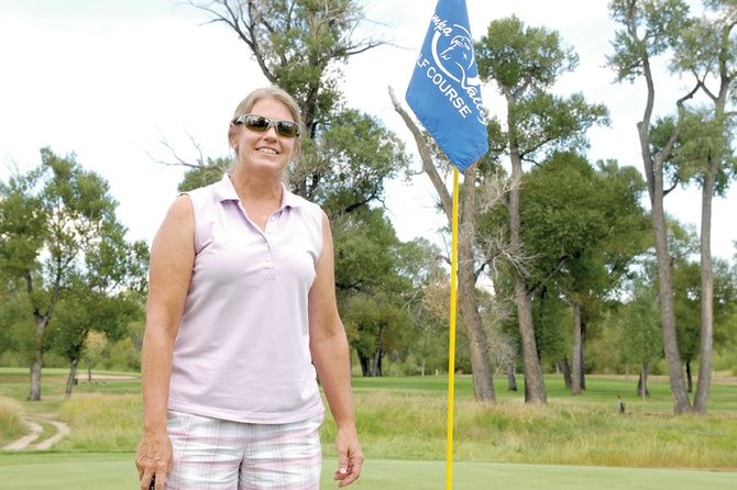 Susan Nicholson, a Craig resident, stands on the 10th hole Wednesday at Yampa Valley Golf Course. Susan and fellow golfer Daniel Brown won club championships in their respective divisions during the 2011 Men's and Ladies Club Championships on Aug. 20 and 21 at the golf course.