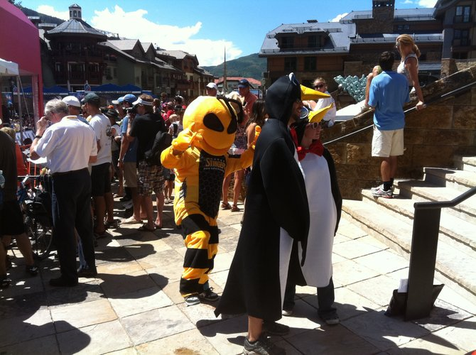 "Corey Prager, dressed as ""Buzz"" the Honey Stinger bee, mixes it up with other costumed cycling fans Thursday in Vail for Stage 3 of the USA Pro Cycling Challenge."