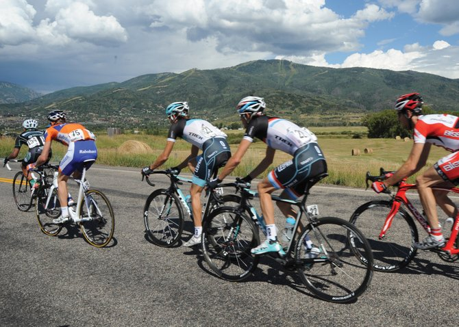Andy and Frank Schleck, center in the Leopard Trek jerseys, enter Steamboat Springs via River Road on Friday during Stage 5 of the USA Pro Cycling Challenge.