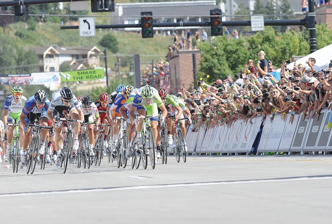 Thousands of spectators cheer as Elia Viviani of Team Liquigas-Cannondale races toward the finish line of Stage 4 of the USA Pro Cycling Challenge in Steamboat Springs on Aug. 26, 2011.
