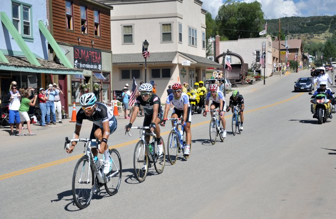 A breakaway group of USA Pro Cycling Challenge racers pass through Oak Creek on Friday afternoon. Hundreds of residents lined main street to watch the cyclists breeze by a sprint finish line.