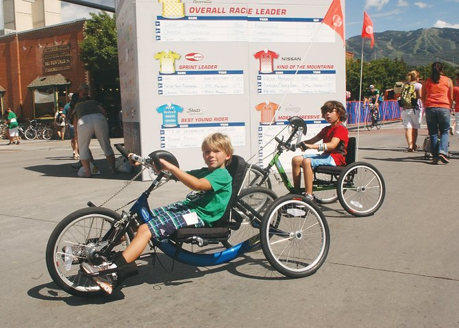 They don't make youngsters bikes like they used to. Logan Spiegel, 7, front, and his brother Alex, 9, had the chance to demo recumbent bicycles during the Lifestyle Expo preceding the USA Pro Cycling Challenge on Lincoln Avenue on Friday.