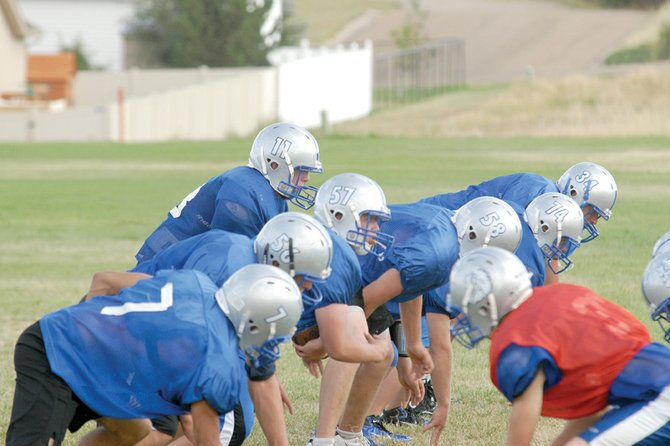 The Moffat County High School varsity football team couldn't overcome costly mistakes in its opener Friday at Evergreen High School, falling 17-7. Head coach Kip Hafey said all his players came to play, but dropped interceptions and muffed handoffs kept the Bulldogs from scoring more points.