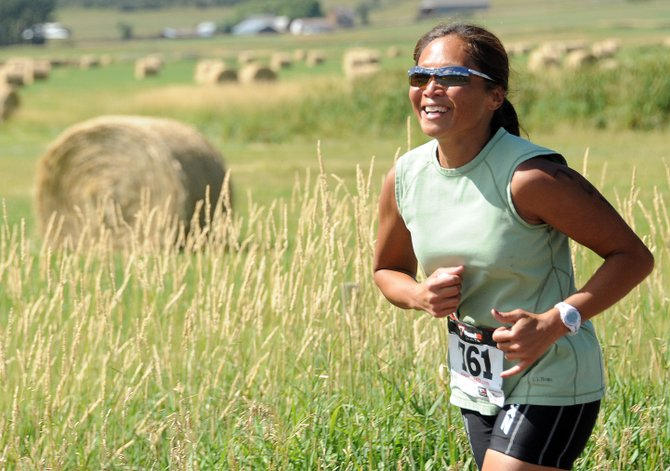 Steamboat Springs' Maria Parekh runs Sunday in the Steamboat Springs Triathlon near Lake Catamount. More than 400 athletes took part in the seventh annual event, which capped a long weekend of athletic events in the Yampa Valley.