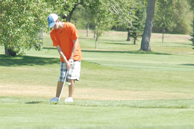 Parker King, a Moffat County High School senior, chips on the 18th hole during a practice round at Yampa Valley Golf Course. King, who finished 44th in the 2010 4A state tournament, is the team's top returning player this season. He said his goal is to make another trip to state.