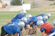 The Moffat County High School varsity football teams lines up in goal-line offense Aug. 24 on the MCHS practice field. The Bulldogs are returning seven starters on both sides of the ball as the team hopes to upend Glenwood Springs and Palisade at the top of the Western Slope League.