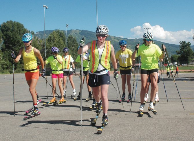 Emily Hannah, center, and her teammates on the Steamboat Springs Winter Sports Club cross-country ski team warm up before a recent interval training session. Hannah recently was named to the National Elite Group, which will give her the opportunity to train with the U.S. Ski Team.