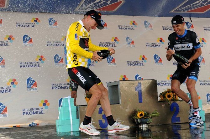 Overall leader's jersey and general classification winner Levi Leipheimer, of Team Radioshack, celebrates with Champagne on the podium along with second overall rider Christian Vande Velde, of Team Garmin-Cervelo, during stage six of the 2011 USA Pro Cycling Challenge from Golden to Denver on Sunday.