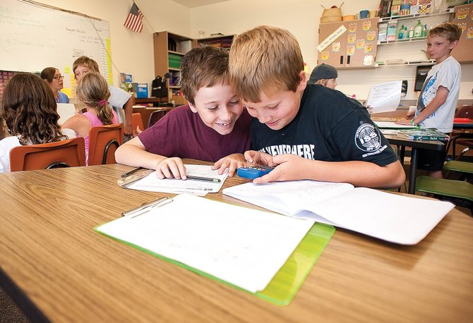 Montessori students Rye Kirchner, right, and Erus Harrington work in class Tuesday afternoon at Strawberry Park Elementary School. The school is looking for an upper-elementary Montessori teacher to replace Linda Stansbery.