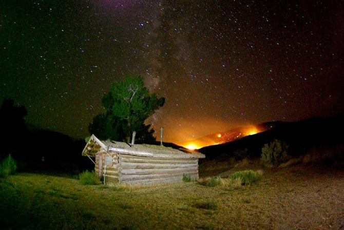 A blaze lights up the night in this photo provided by the Bureau of Land Management. The Ladore Fire, two miles northwest of the Gates of Ladore in the BLM Diamond Breaks Wilderness Study area, reached 1,072 acres Tuesday.