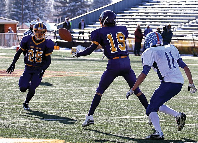 Rex Stanley, a Little Snake River Valley School senior, tosses the ball to fellow senior Daniel Wille during the 2010 Wyoming 1A six-man football championship in Laramie, Wyo. The Rattlers' varsity team will open the 2011 season Saturday against Ten Sleep High School in Baggs, Wyo.