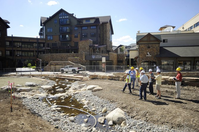 Urban Renewal Area Advisory Committee members tour the promenade construction project Thursday at the base of Steamboat Ski Area.