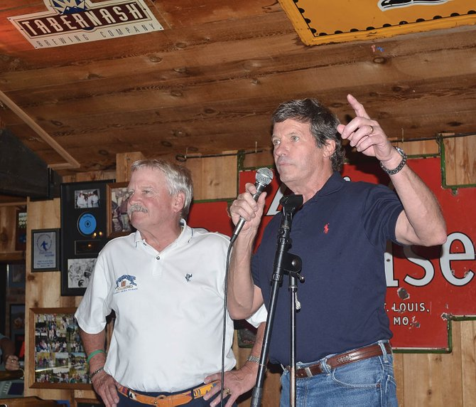Hank Edwards and Larry Lamb were celebrated Tuesday night by a crowd of loyal patrons as they formally announced the sale of The Tugboat Grill & Pub.