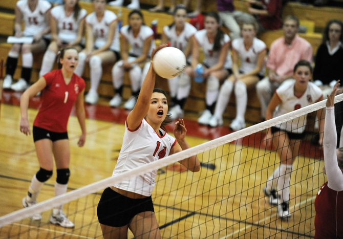 Steamboat Springs High School senior Maggie Stanford goes up for a kill during a 2009 match against Glenwood Springs High School. Stanford returns to the squad this year along with most of the 2010 team. Coach Wendy Hall hopes the team will be in the running for a league title.