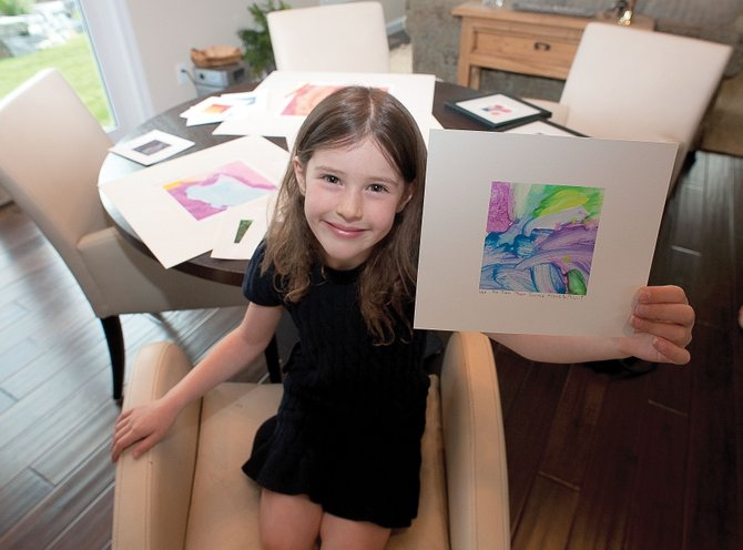 Artist Kali Waldman, 5, displays her work inside her parents' Steamboat Springs home while preparing for an upcoming art show. Kali will have her first art opening from 5 to 8 p.m. Friday at City Cafe inside Centennial Hall.