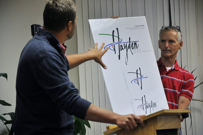 Hayden Economic Development Commission Chairman Stef Nijsten, left, shows the Hayden Town Council a new logo, held by Town Manager David Torgler, that the Commission would like to use in branding and marketing efforts.