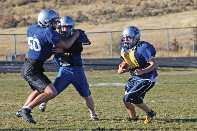 The Moffat County High School varsity football team will rely on their backfield, including junior halfback Garrett Stewart, right, to help get past Aspen High School at 7 p.m. today at MCHS, 900 Finley Lane. The Bulldogs (0-1) rushed for more than 200 yards last week against Evergreen High School.