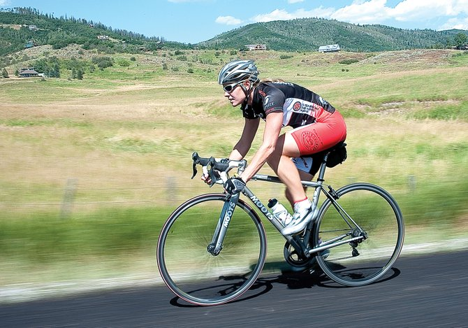 Local cyclist Amy Charity rides along River Road to practice for the Steamboat Springs Stage Race.