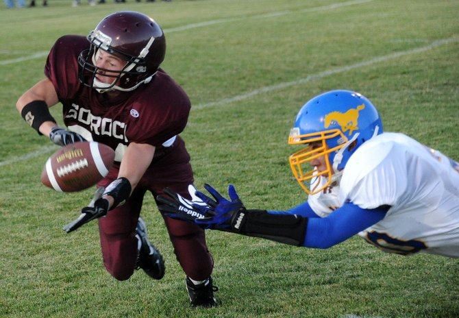 Soroco's Taylor Hammer dives to attempt an interception Friday as the Rams beat Nucla, 44-18.
