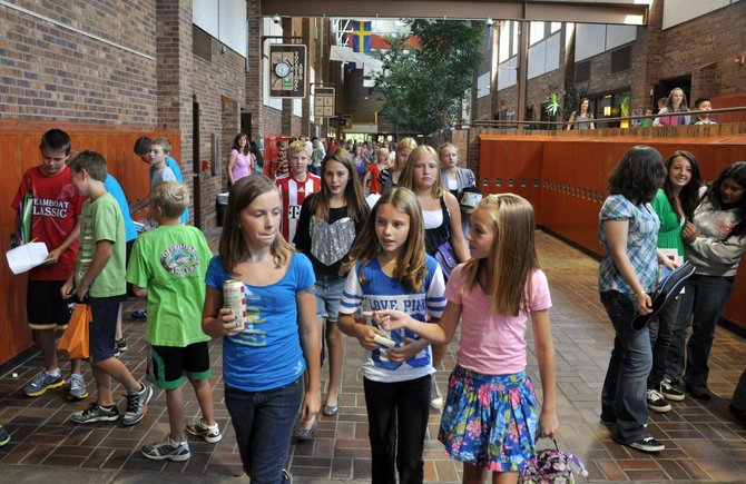 Sixth grade students, from left, Hanna Spence, Julia Gibbs and Amy Speer walk to their next class Aug. 24 at Steamboat Springs Middle School during the first day of classes. Steamboat's sixth grade class is projected to have grown to 184 students from 170 last year.