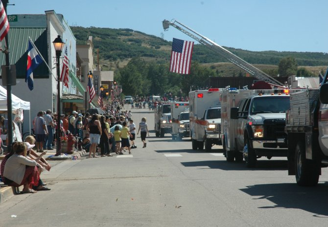 Oak Creek Fire Protection District emergency services vehicles head down Main Street during the annual Labor Day parade Monday in Oak Creek. Longtime residents Mary Deppe and Paul Rutledge were honored as the parade's grand marshals.